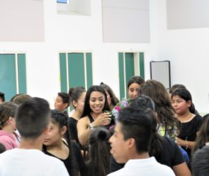 Students came to thank dance instructor Kathia Herrera (center) at the end of summer assembly. Photo by Becky Bonner.