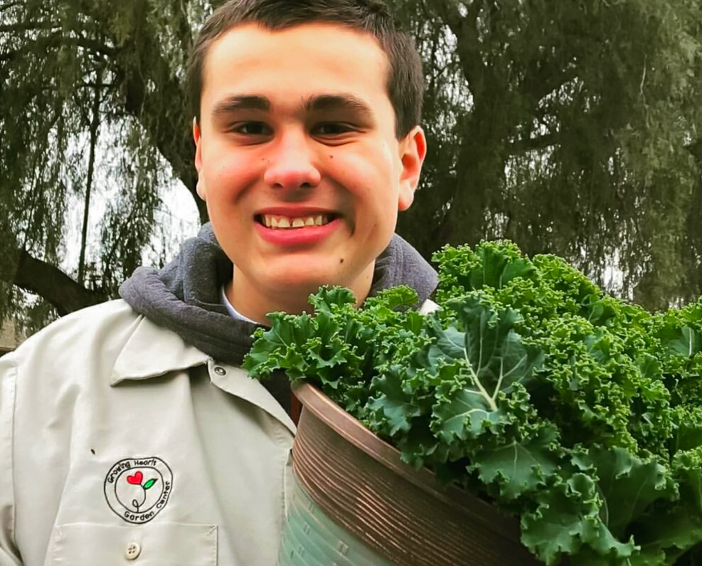 Mason Churchill, a 17-year-old with fragile x syndrome, has blossomed since starting work with Growing Hearts Garden Center. Photo provided by Chris Evans.