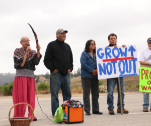 Ann-Marie Sayers speaks at a PORC demonstration in July against the Highway 101 commercial nodes. Photo by Noe Magaña.