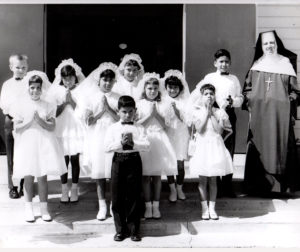 The late-Franciscan Sister Rose Marita Lake, SA (right), with San Juan youth making their First Holy Communion, circa 1960s. Photo courtesy of David Medeiros.