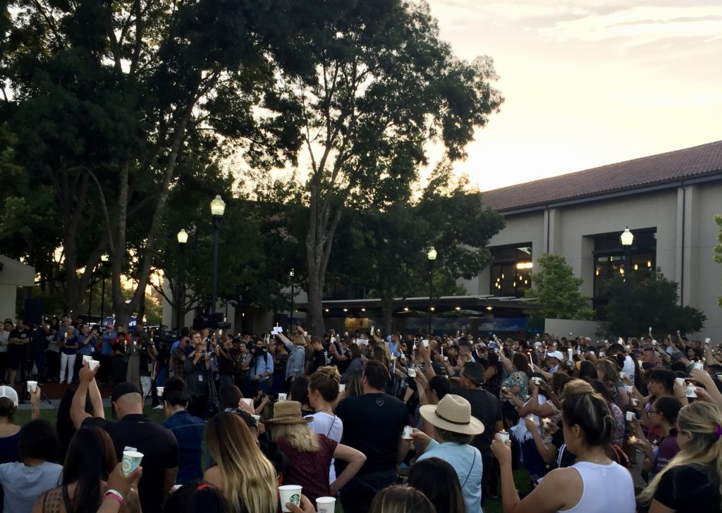 Gilroy community members hold up candles at a July 29 vigil for the victims of the Garlic Festival Shooting. Photo by Nicholas Preciado.