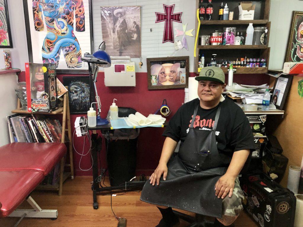 Fabian Herrera at his station inside Faultline Tattoo. Photo by Melissa Melton.