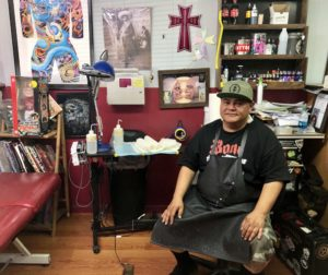 Fabian Herrera at his station inside Faultline Tattoo. Photo by Melissa Melton.