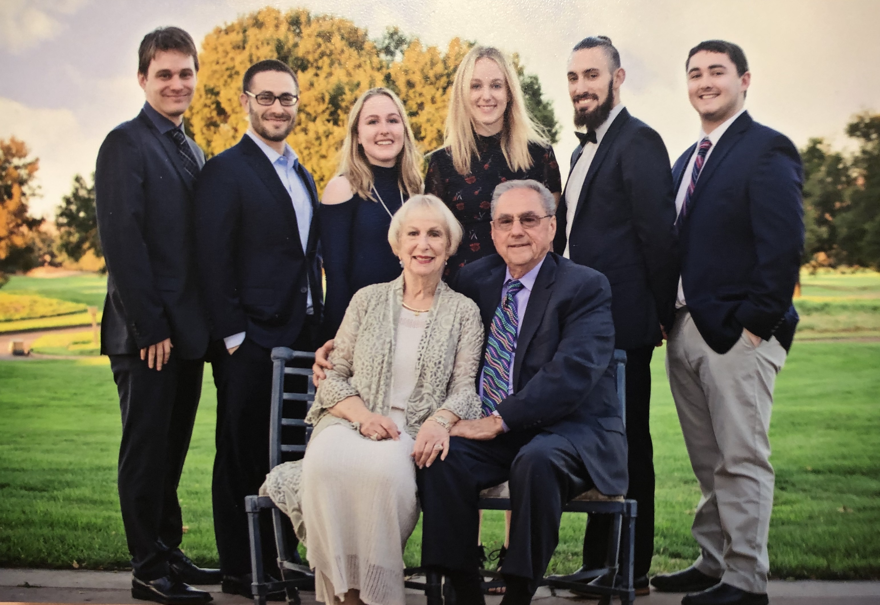 Marilyn Ferreira sits with her husband and her six grandchildren. Photo provided.