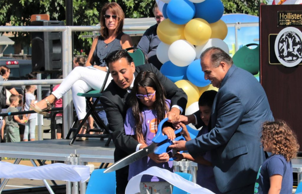 Hollister Mayor Ignacio Velazquez and County Supervisor Jaime De La Cruz cut the ribbon with youngsters from YMCA, officially opening McCarthy Street Park. Photos by John Chadwell.