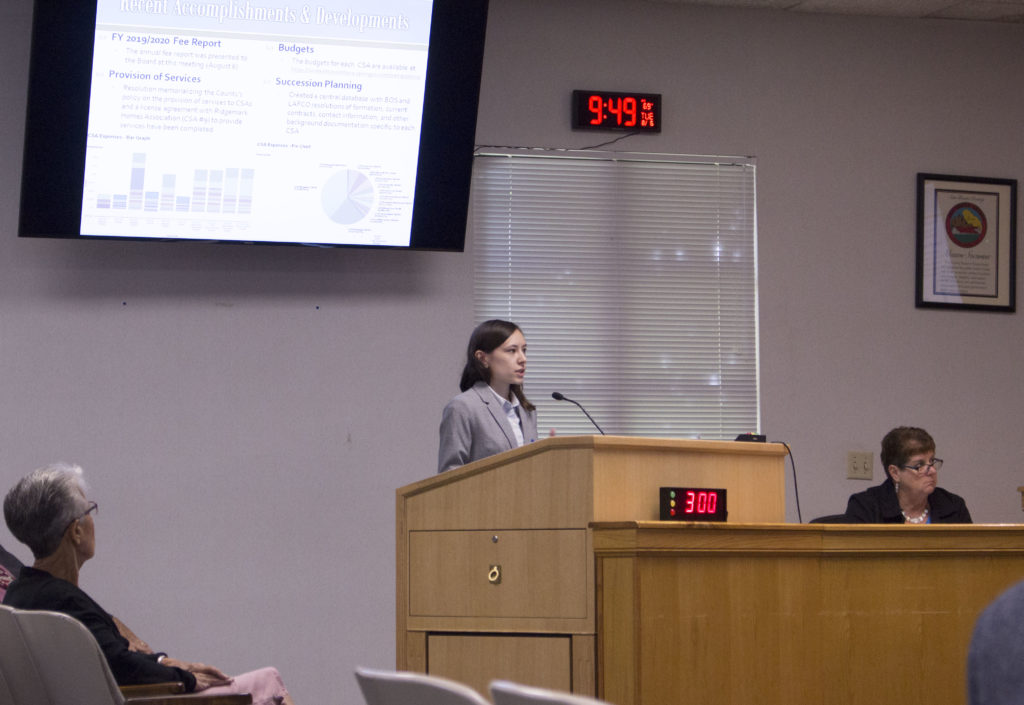 Management analyst Lauren Hull presents an update regarding county service areas at the San Benito County Board of Supervisors meeting on Aug. 6. Photo by Noe Magaña.