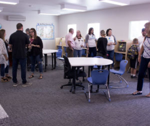 Attendees tour the new classroom after the ribbon-cutting ceremony. Photo by Noe Magaña.