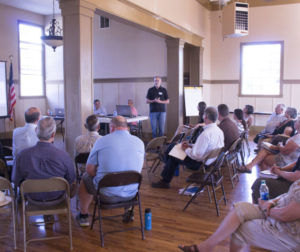Martin Carver speaks during the housing element workshop at the community center. Photo by Noe Magaña.