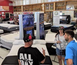 Custom Fundraising Solutions San Jose owner Sam St.Germain (right) listens to a potential customer at the Aug. 25 mattress sale at SBHS. Photos by Becky Bonner.