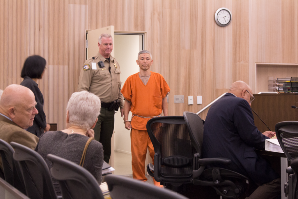 Sang Ji walks into the courtroom at the July 31 hearing. Photo by Noe Magaña.
