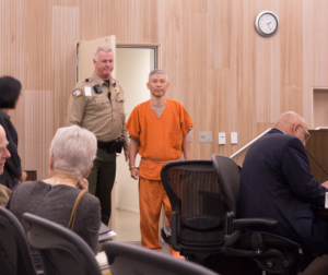 Sang Ji walks into the courtroom at the July 31 hearing. Photo by Noe Magaña.