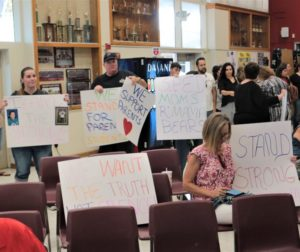 Parents and educators held signs in silence at the SBHS board meeting on Aug. 14 as speakers spoke of their concerns about alleged incidents in a special ed classroom. Photo by John Chadwell.