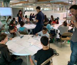 Professors and teaching assistants introduce students to 8th grade algebra. Photo provided.
