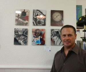 Hollister firefighter Vince Grewohl stands next to his art on display. Photo by Carmel de Bertaut.