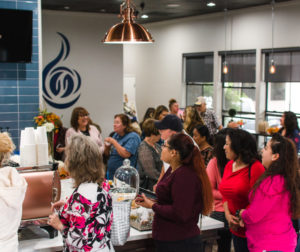Locals mingle over coffee at Be True Cafe's ribbon-cutting ceremony on Sept. 27. Photo courtesy of Victor Terrazas, Modality View.