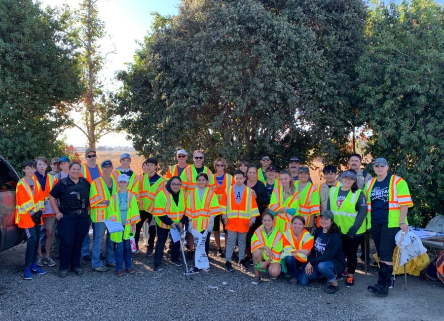 Group shot of the volunteers who helped pick up over 700 pounds of trash from the banks of the San Benito River on Sept. 21. Photo Courtesy of Celina Stotler.