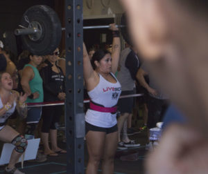 Stacie Phillips participates in the first of four workouts as her teamate Kristy Park cheers her on. Both competed at the Granite Games in Hollister on Sept. 14. Photos by Noe Magaña.