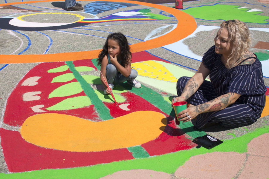 Lyandra Lisaola and her daughter, Zenya Vaca, traveled from Watsonville to work on the mandala. Photo by Noe Magaña.