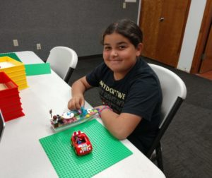 Ten-year-old Venessa Quintana building a boat at the Lego Club, hosted Sunday afternoons at the San Benito County Free Library. Photos by Carmel de Bertaut.