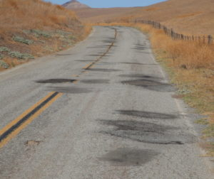 Patches lead the way along county roads. Photo by Robert Eliason.