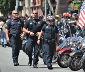 Police officers patrol the 2013 Hollister Independence Rally. Photo by John Chadwell.