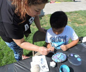 Susana Valle and son Gael paint a rock together. Photos by Patty Lopez Day.