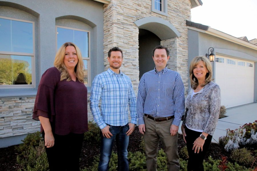Anderson Homes team members stand in front of a Santana Ranch home. L to R: Alisa Collins, James Anderson, Michael Anderson and Tami Selski. Photo by Robert Eliason.