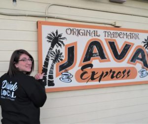 "Java Express Manager Brooke Taylor proudly showed her sweater that encourages people to ""Drink Local."" Photos by Becky Bonner."