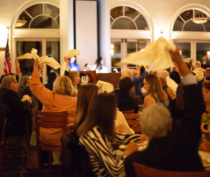 Attendees wave their napkins in the air in celebration of the honorees. Photos by Raul Ceja.
