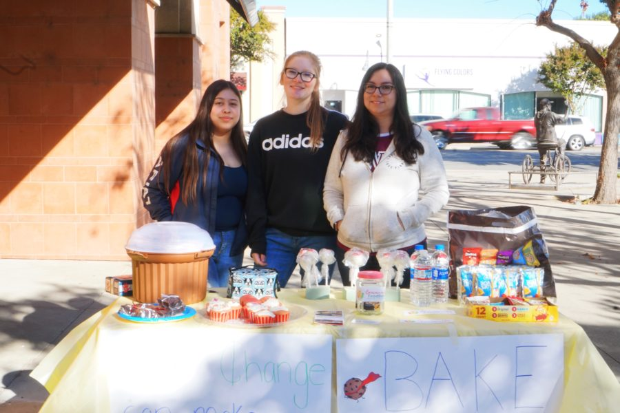 Gavilan students Cristal Nunez Sedano, Stephanie Perez and Sara Bowman raising funds for the Community FoodBank outside the Briggs Building in Hollister. Photos provided by Shaina Garcia.
