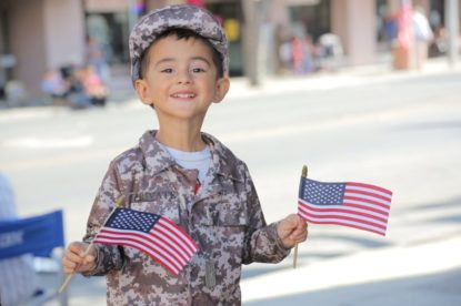 James Texaria, 3, honoring his dad Trent who is serving in Iraq. Photos by Robert Eliason.