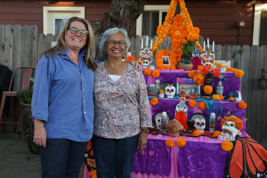 Melodie Schwabacher decorated the 18th Barrel courtyard for the evening. She stands next to her friend and workshop buddy Mona Asunción, who helped put it all together. Photo by Leslie David