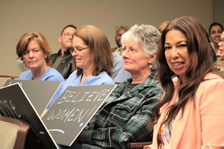Catherine Booth Vaughn, Cheryl Vaughn Booth, Kathi Morris and Elia Salinas protested Eckert's hiring.