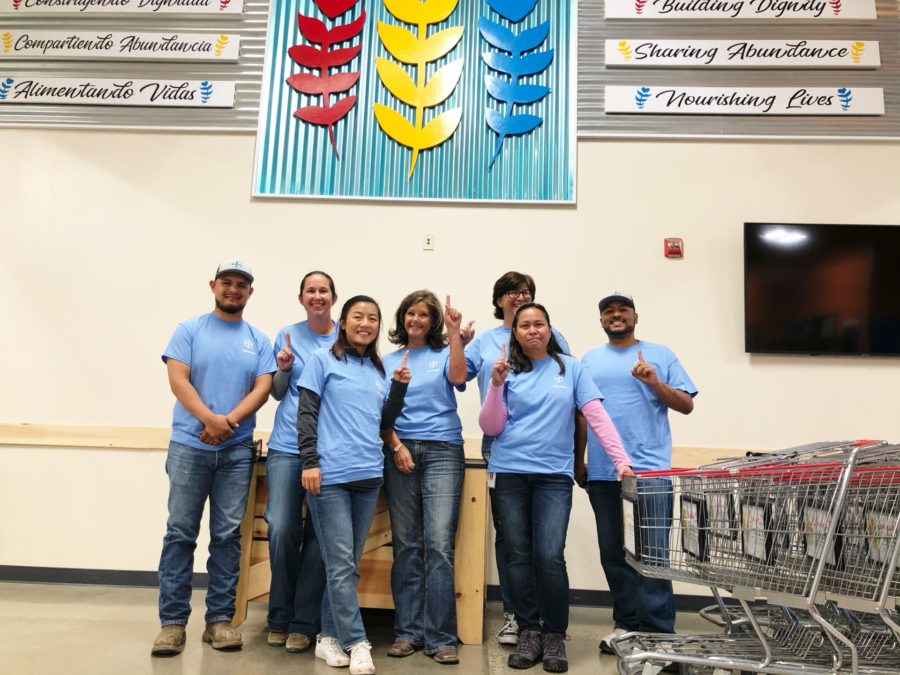 A volunteer team from Bayer U.S. readies the marketplace for grocery shoppers.