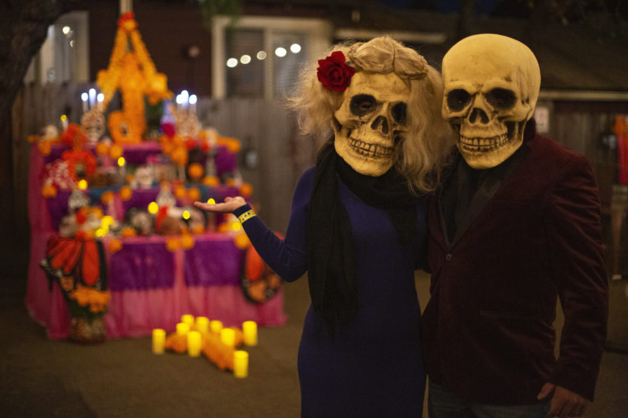 Out on the town and celebrating the inevitable cycle of life, one couple poses before the altar designed for the BenitoLink Dia de Los Muertos celebration at 18th Barrel on Nov. 1. Photos by Raul Céja and Leslie David.