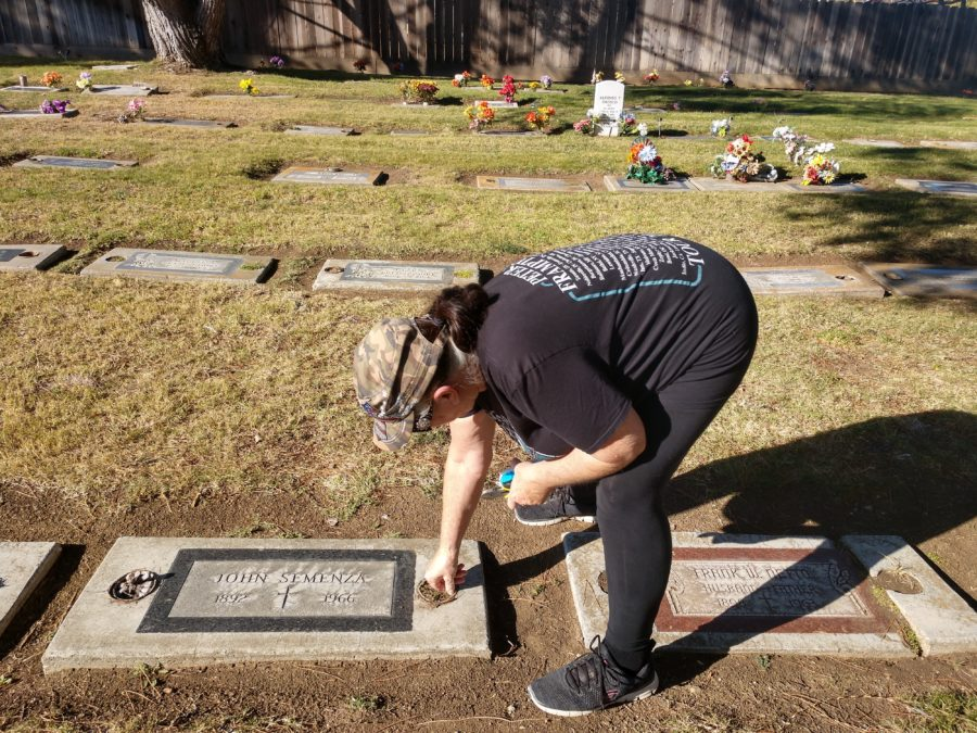 Bonturi tending a grave.