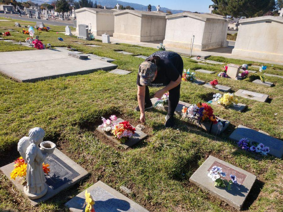 Brenda Bonturi tends to a the grave of a friend's young niece. Photos by Carmel de Bertaut.