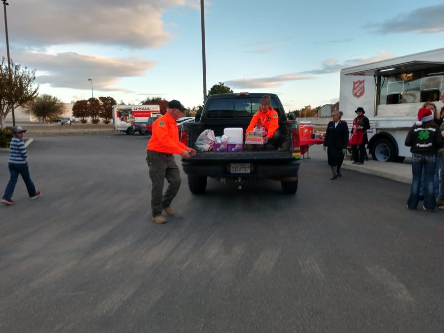 SBC Search and Rescue drop off food and gifts.