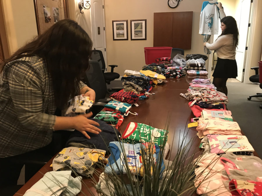 CASA of San Benito staff organizes the donated pajamas. Photo provided by CASA.