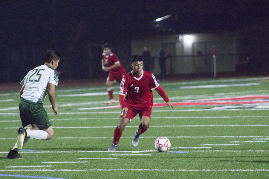 Jorge Molina dribbles past a Greenfield player during a match on Dec. 4.