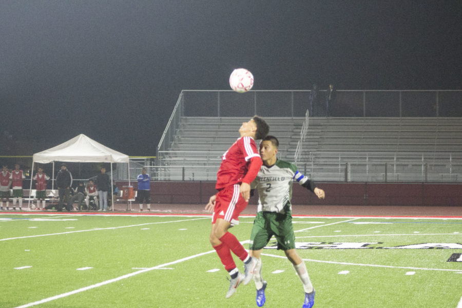 Forward Jorge Molina fights for the ball during a match against Greenfield.