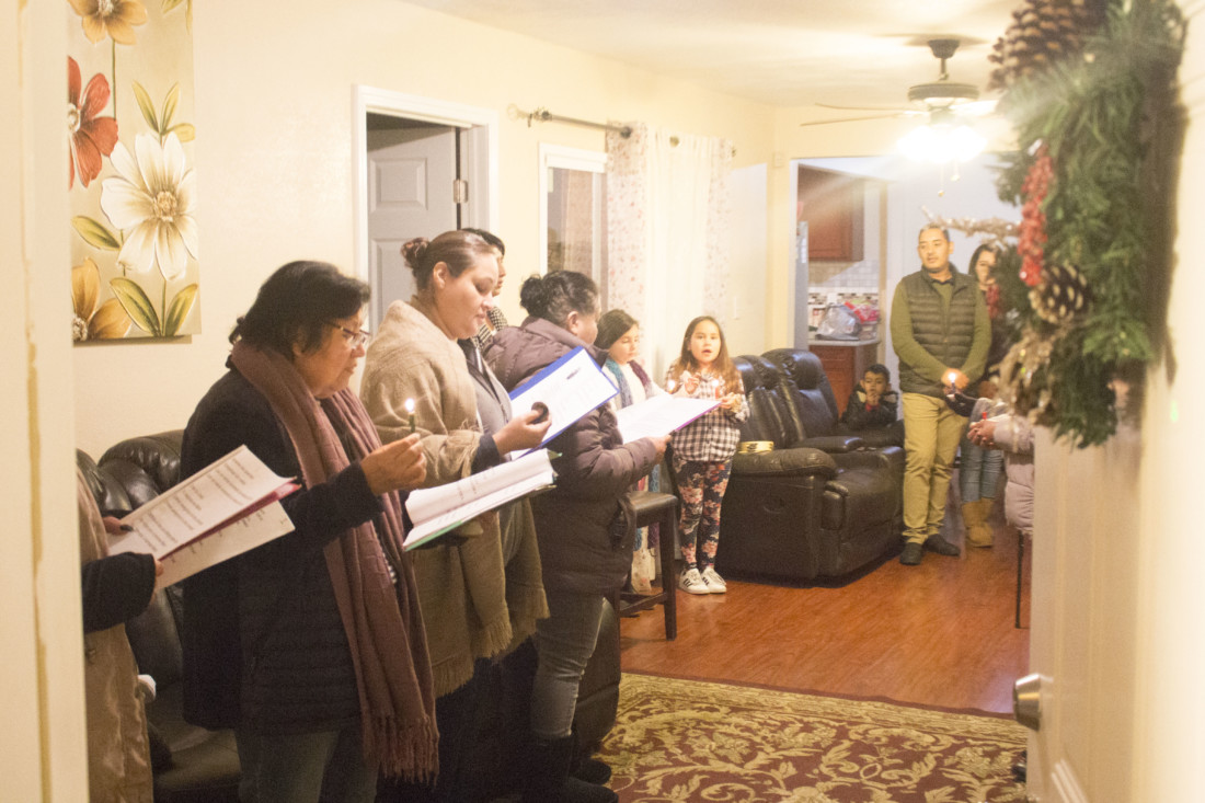 Once given a place to stay, the group representing Joseph and Mary enter the house and sing the last hymns. Photo by Noe Magaña.