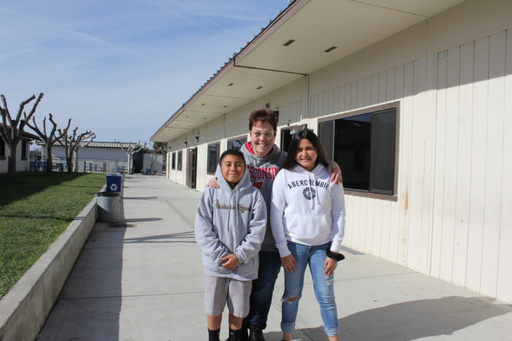 Student Robert Rendon, teacher Teresa Stevens and student Isabella Favaloro at Maze Middle School. Stevens has asked her sixth-grade students to keep a kindness journal to show how kindness can be extended to everyone. Photo by Carmel de Bertaut.