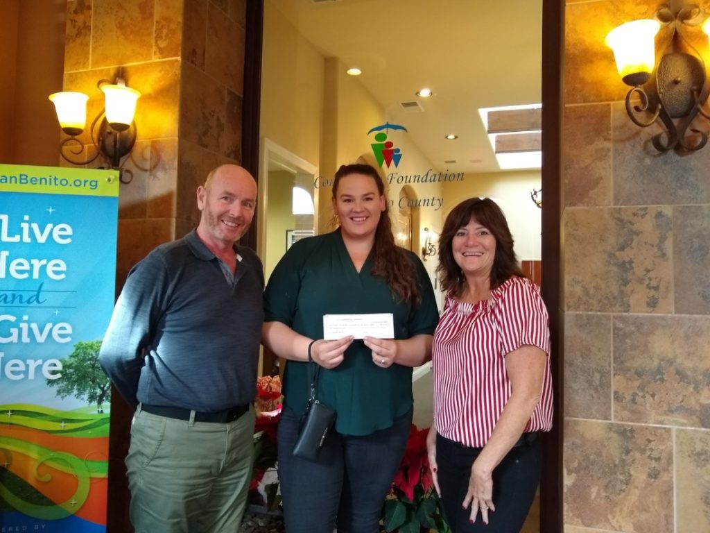 Christy Schroeder with Anderson Homes gives a check to Gary Byrne (left) and Tracy Taggart (right), both with the Community Foundation for San Benito County. Photo by Sharlene Van Rooy.