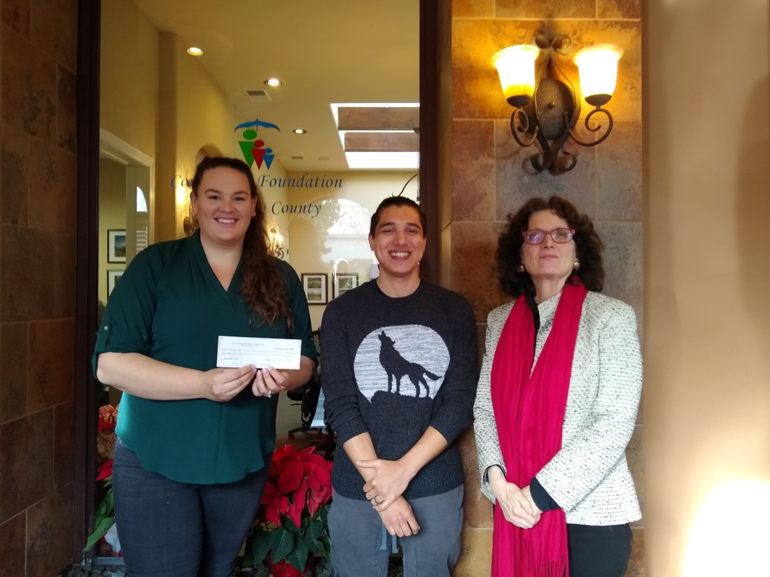Schroeder brings by donation to BenitoLink Content Manager Nicholas Preciado and Executive Director Leslie David. Photo by Sharlene Van Rooy.
