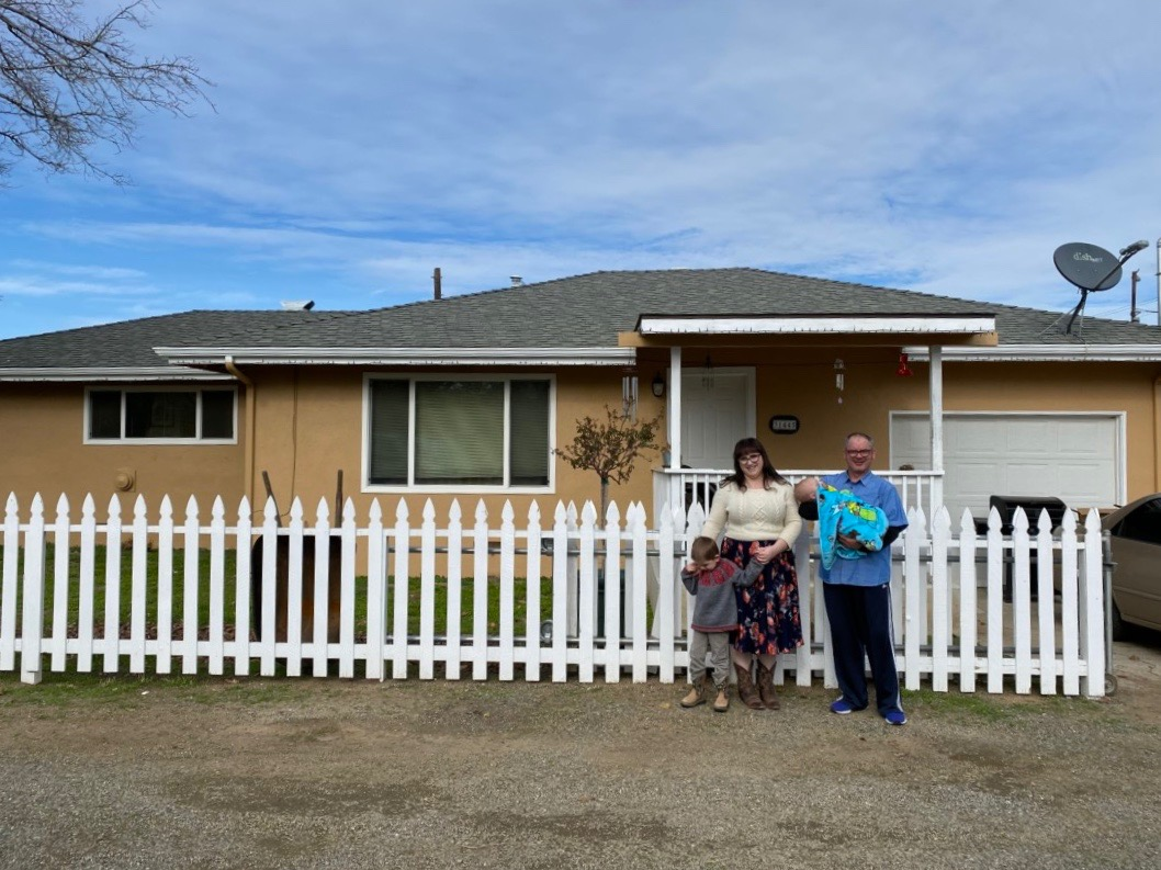 Amanda McCraw and family in front of their house. Photo by Kaitlyn Fontaine.