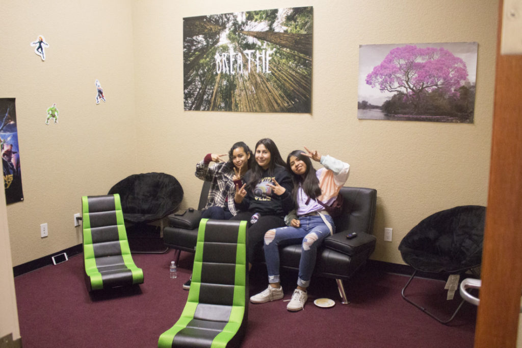 Bryanna Morales, 15, Angela Martinez, 14, and Ariana Ventura, 15, hang out in the video game room at the Esperanza Center in Hollister during the Jan. 6 grand opening of the youth drop-in center. Photos by Noe Magaña.