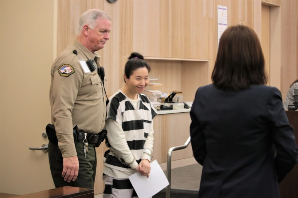 Jung Choi smiles at her interpreter as she enters the courtroom on Jan. 24. She pleaded no contest to voluntary manslaughter. Photo by John Chadwell.