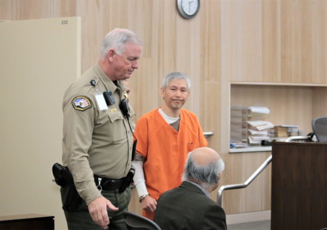 Sang Ji enters the courtroom.