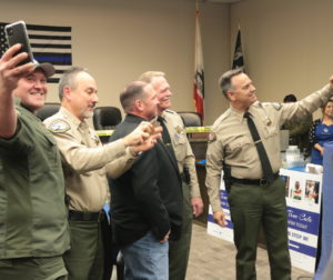 Sheriff Darren Thompson and deputies take a selfie with retiring Hollister Police Chief David Westrick. Photos by John Chadwell.